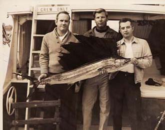 My father (middle) posing with a nice sailfish